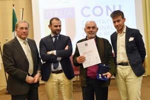 Sergio Poggi riceve la Stella di Bronzo in qualità dei cinquant'anni di attività svolti come Giudice di Gara